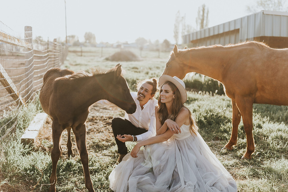 Couple with their horses.