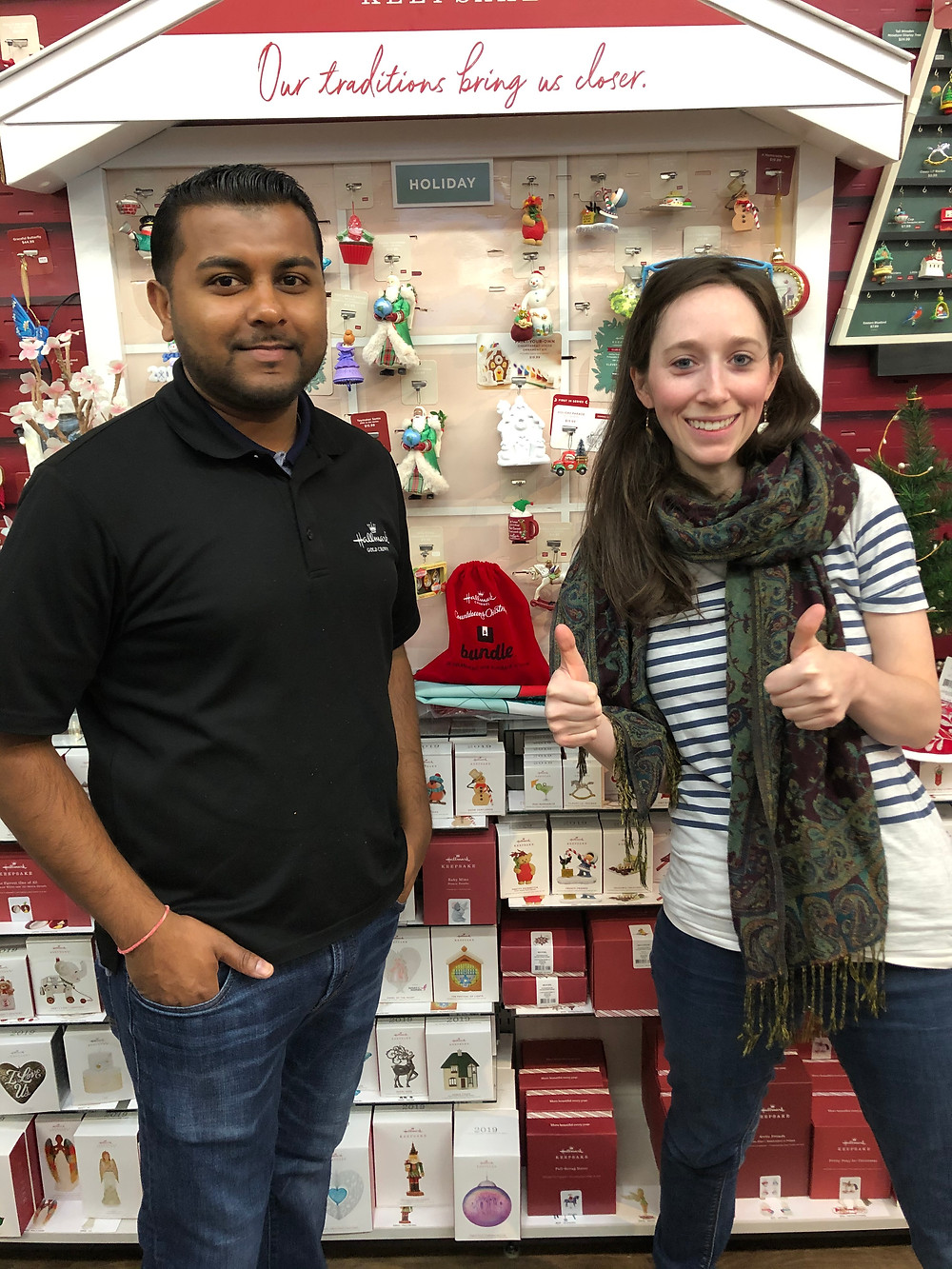 Cassie standing with Hallmark employee in front of game