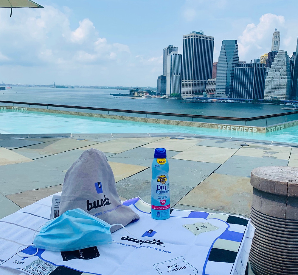 New York City skyline with a pool and sunscreen and board game and mask