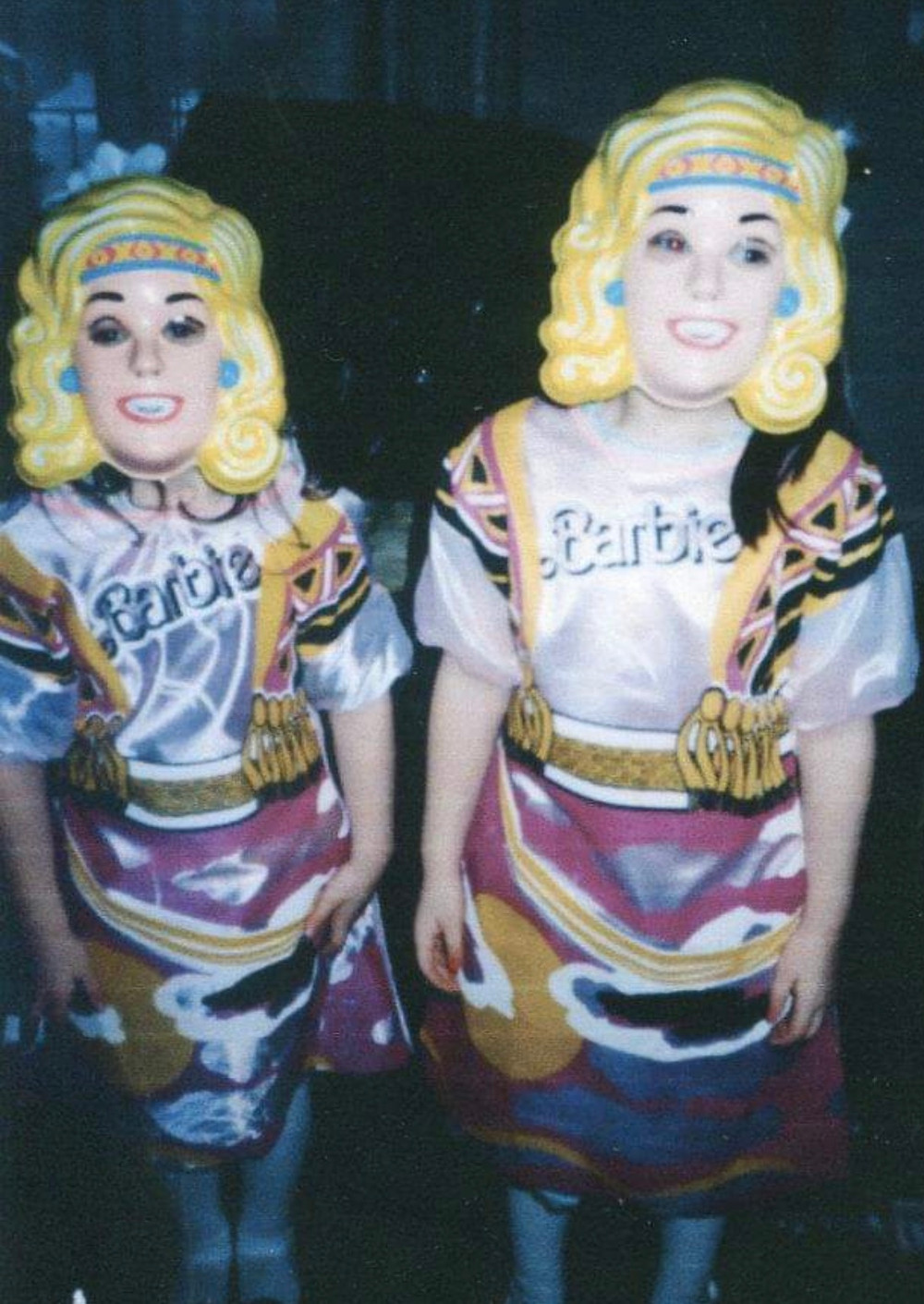 Two young girls in Barbie costumes.