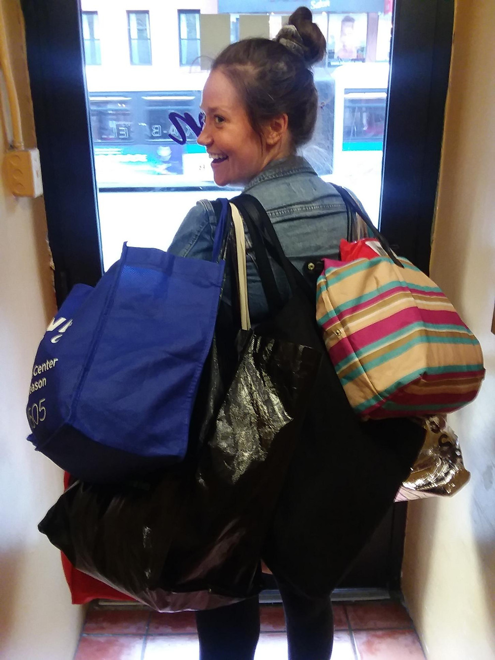 Jackie carrying several bags.