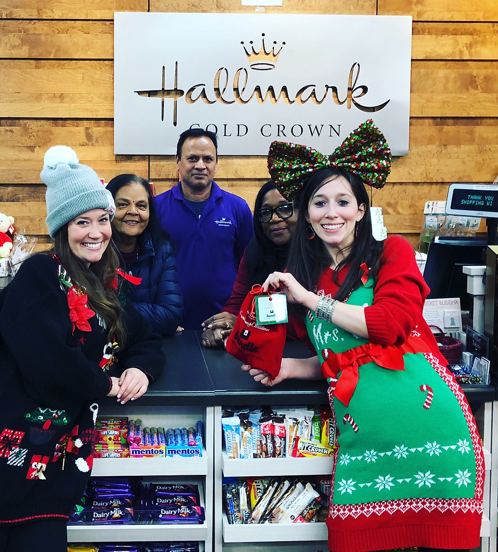Jackie and Cassie with the Hallmark Gold Crown Store Team!