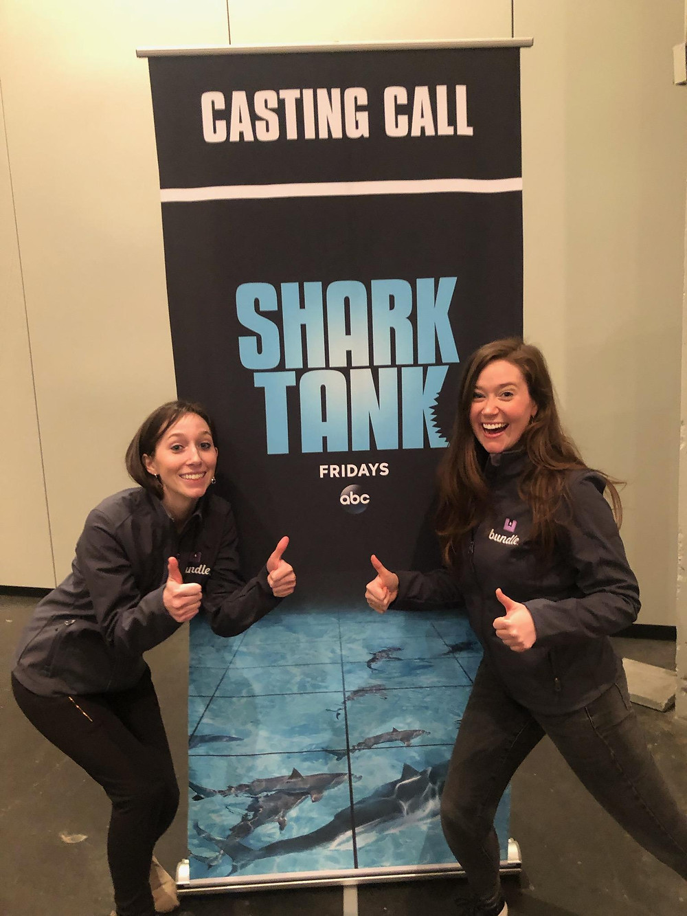 Cassie & Jackie in front of Shark Tank sign.