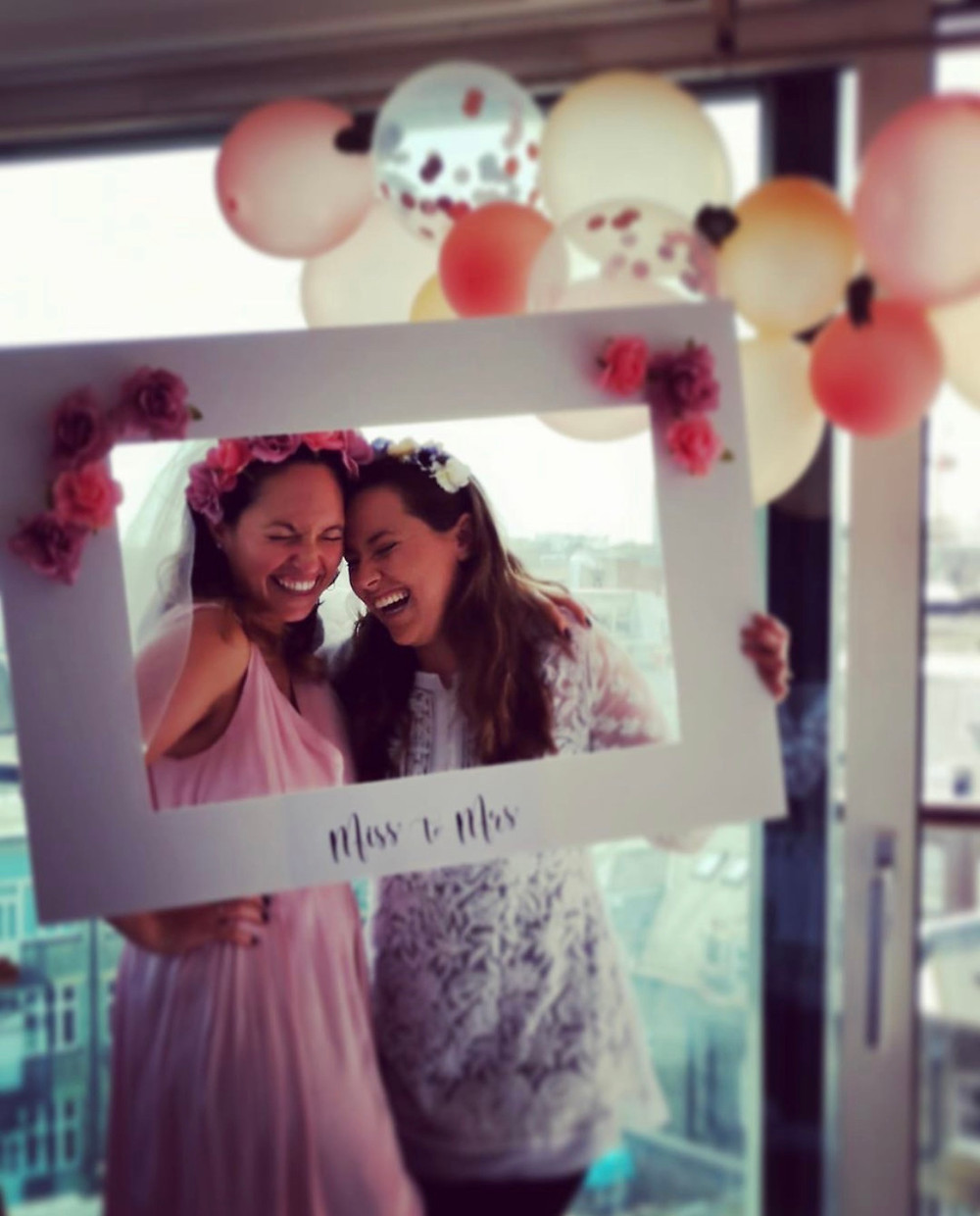 Bride smiling with her maid of honor.
