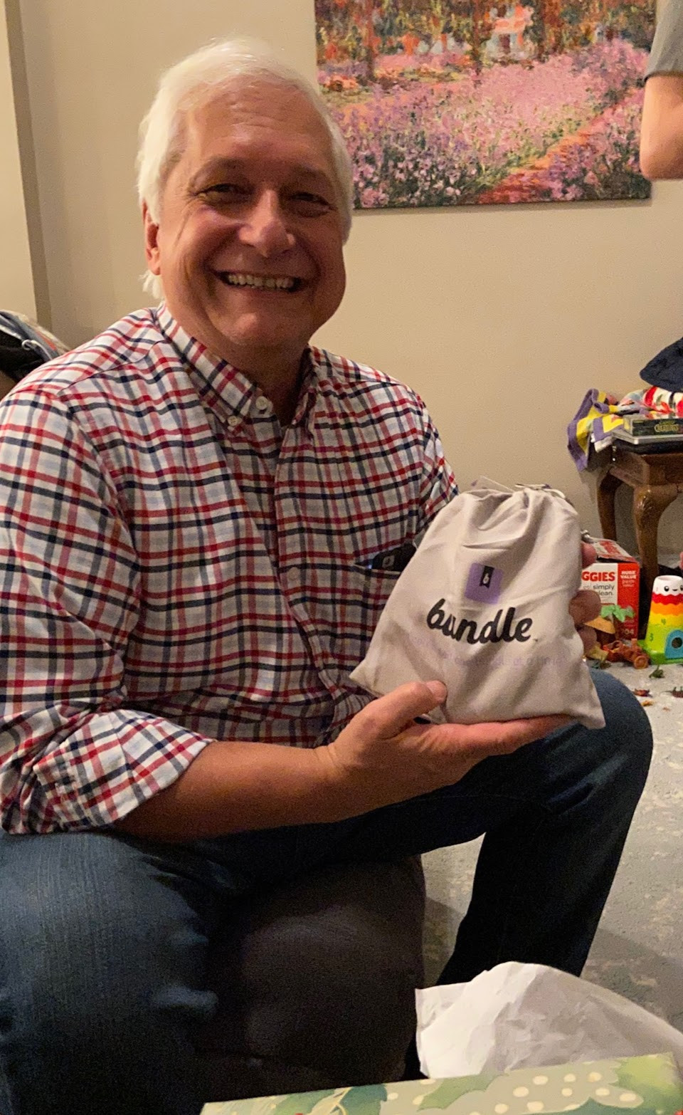 Dad Bort excitedly holdiing the personalized Family Bundle with a huge smile on his face.
