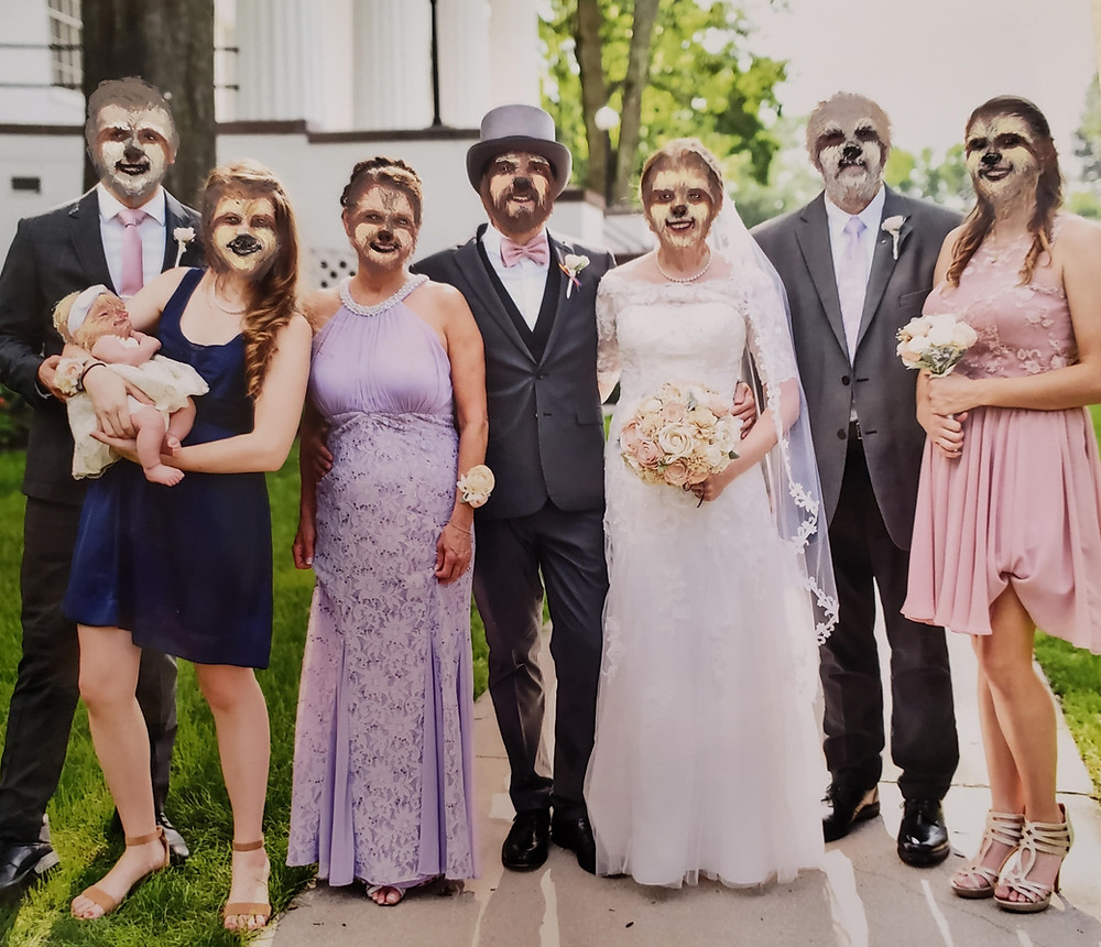 A family of 8 at a wedding with sloth faces.