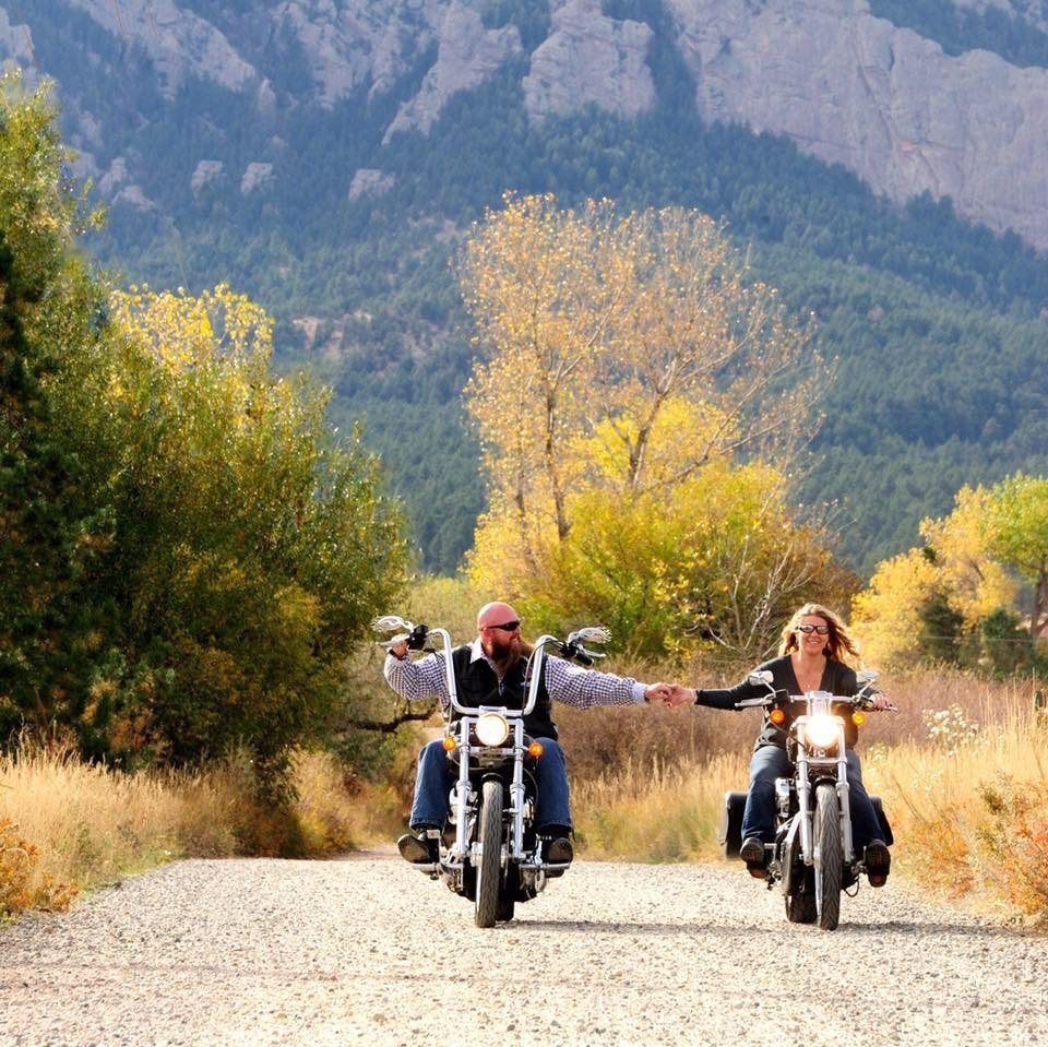 Couple holding hands riding motorcycles