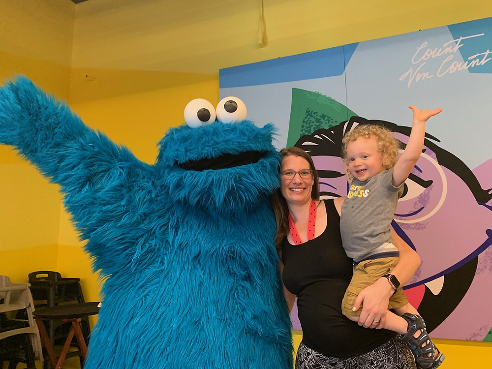 toddler, mom, and Cookie Monster at sesame place