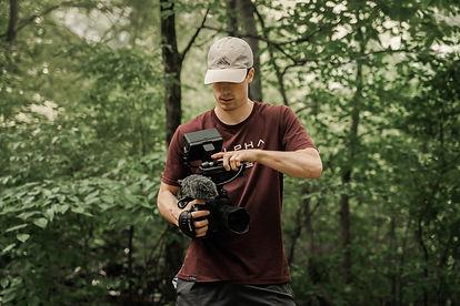 Brandon in Woods w- Camera.JPG