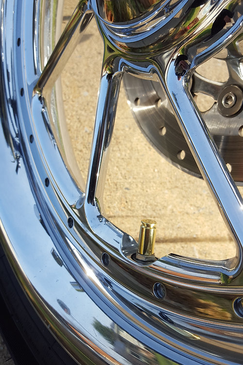 Hollow-Point Gear Bullet Valve Caps on Motorcycle