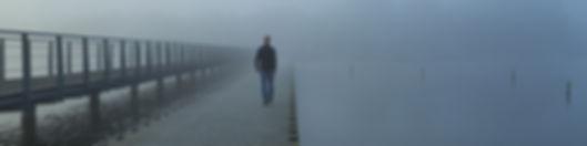 man on boardwalk