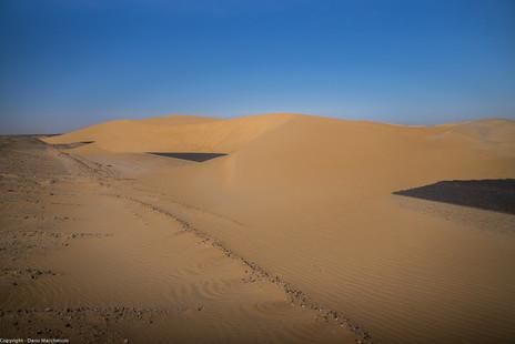 Dunes overtaking a road