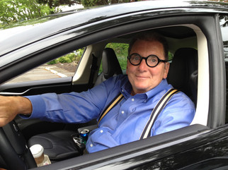 Gene Colin driving his proudly-owned Tesla