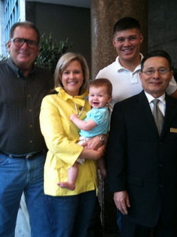 Gene Colin (left) with son Ryan Hazlett (top right) and family