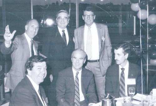 Gene Colin (top right) and AGC of Washington collegues