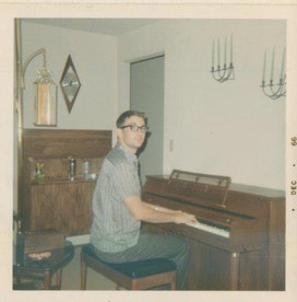 Gene Colin playing piano at a young age