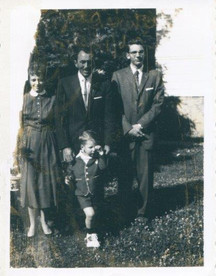 Gene Colin (front) and family
