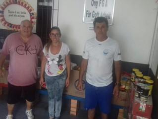 AABB entrega alimentos para instituição social
