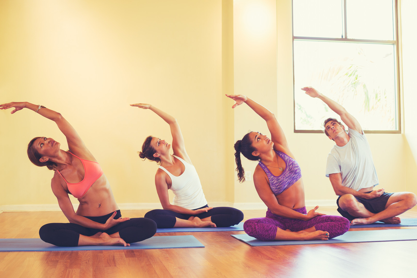 Group of People Relaxing and Doing Yoga.