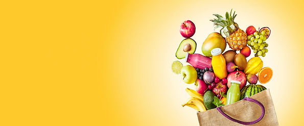 Colorful yellow panorama banner with copy space of a large assortment of fresh tropical fr