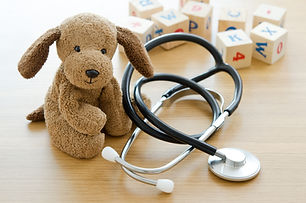 Pediatrics. Puppy toy with medical equip