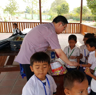 President giving gifts to children