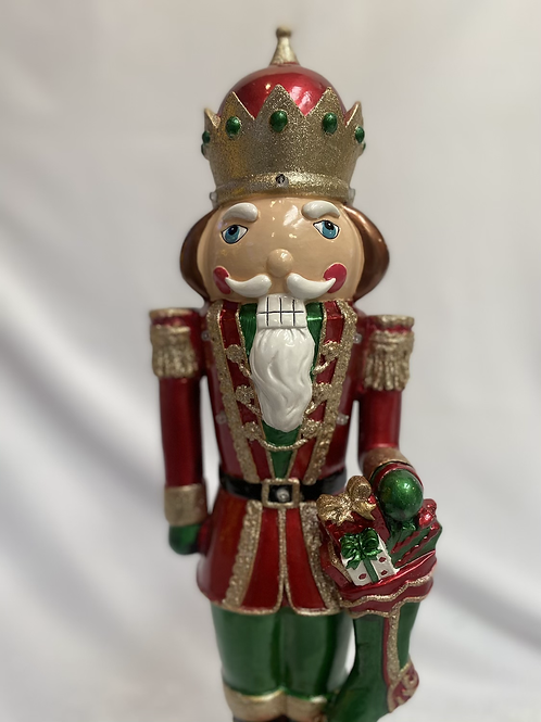 Medium musical red nutcracker with stocking