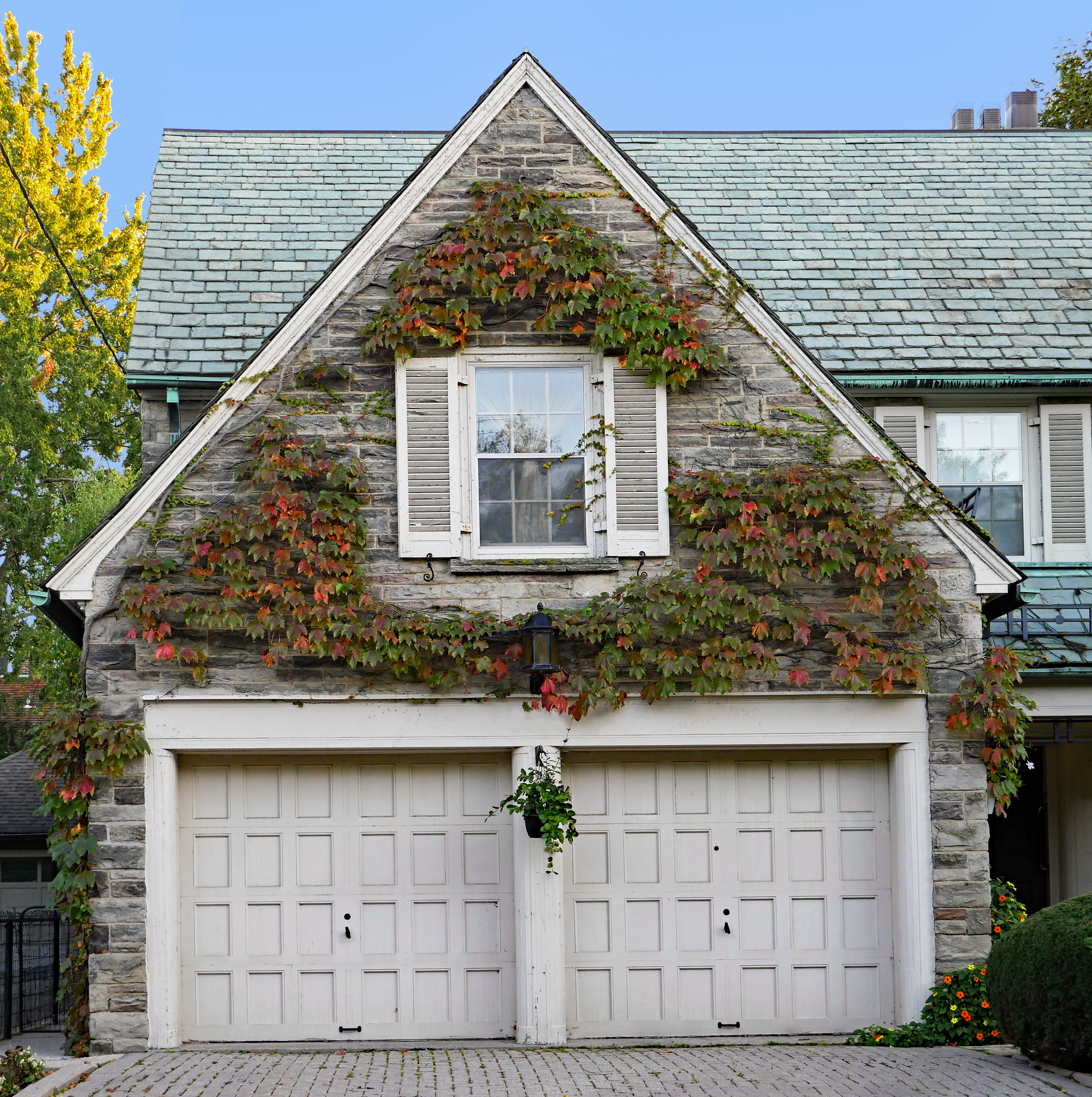 Stone gable above garage doors with colo