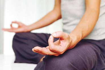 Employee attending meditation class in the workplace