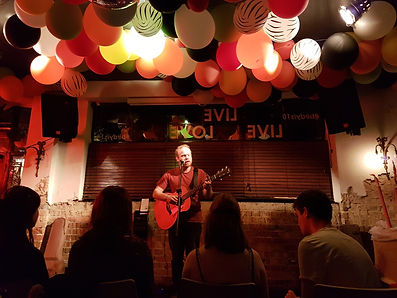 Richard Sutton, playing acoustic at the Birdcage, Norwich
