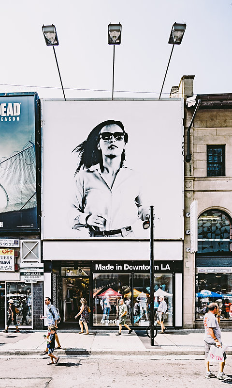 photo-of-billboard-of-woman-in-black-and