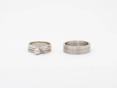 Witgoud, titanium, grijze parel en diamant