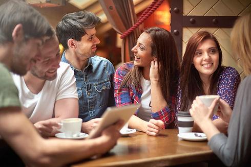 group-friends-enjoying-coffee-shop.jpg