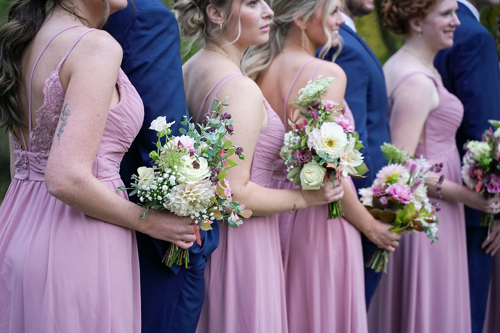 the maids' bouquets are all a bit different and compliment the dusty rose gowns