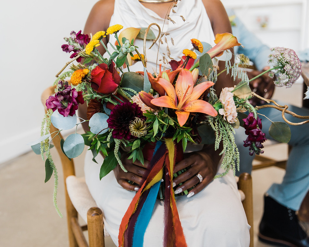garden-styled seasonal flowers gathered with colorful silk ribbon