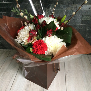 red/white blooms hand-tied