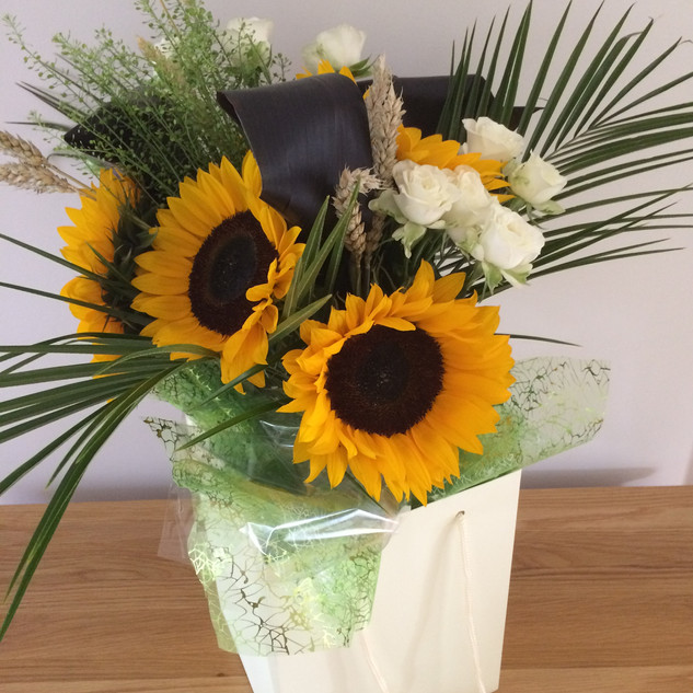 Sunflower with palm leaves