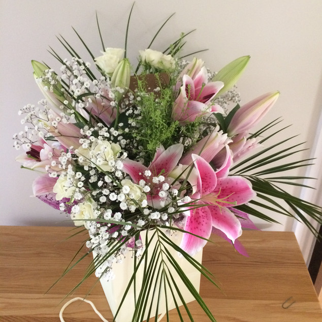 Lilly and roses hand-tied