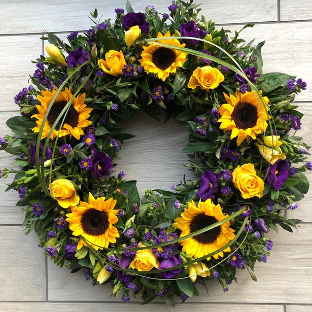 Sunflower wreath with beargrass