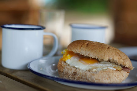 Camping & Glamping Holidays - Breakfast in the Dutch Barn