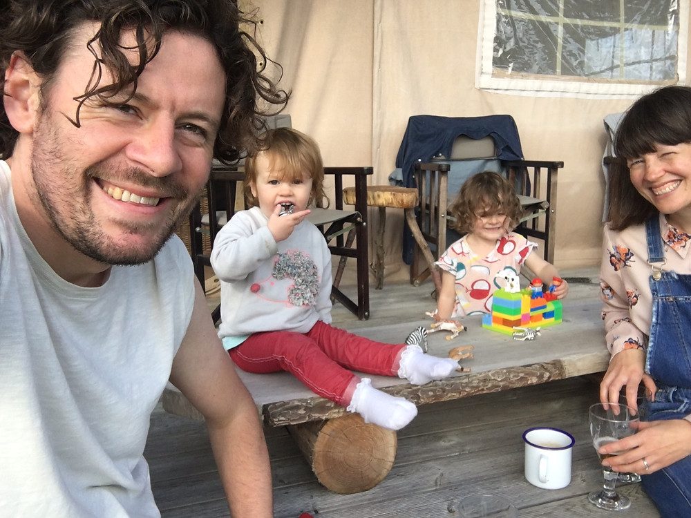 Melissa, her husband & two daughters relaxing and having family fun time outside of their Eco Boutique Safari Lodge