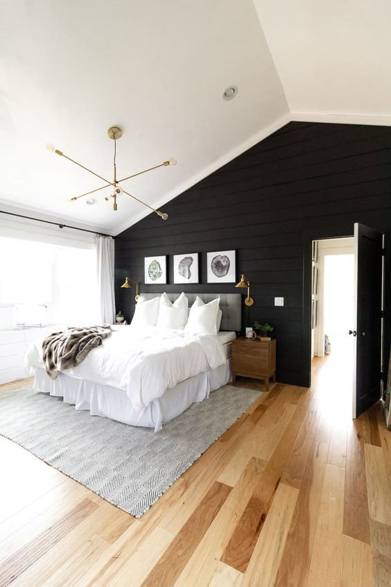Bedroom with Black Walls next to bright window