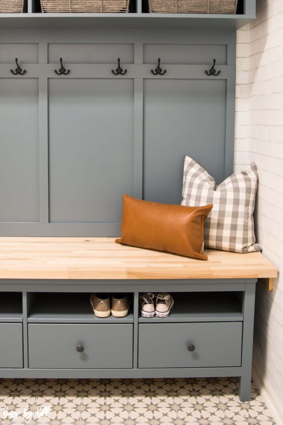 Teal mudroom bench with patterned pillows