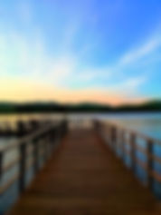 Take Life Back wooden walkway on body of water at sunset photo