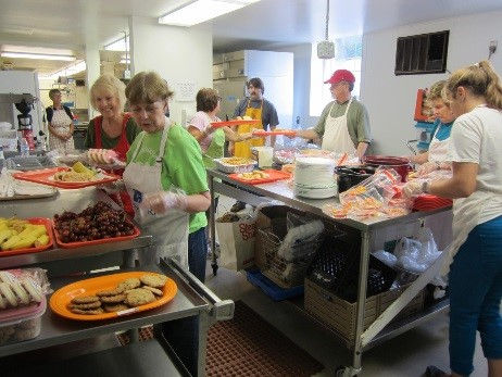 Feeding the hungry at Loaves and Fishes.