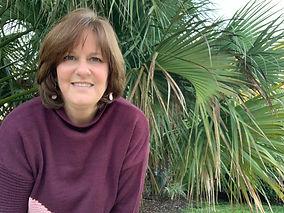 Jodi Henson and palm tree photo