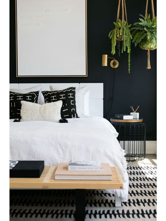 Bedroom wtih black walls and white accents