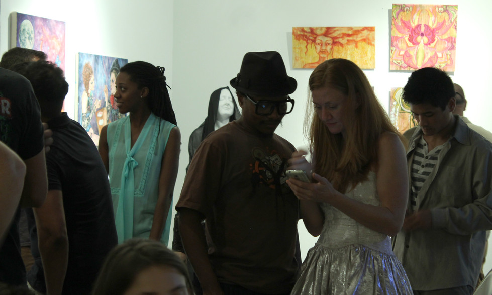 Akim and Susanne chatting about the art
