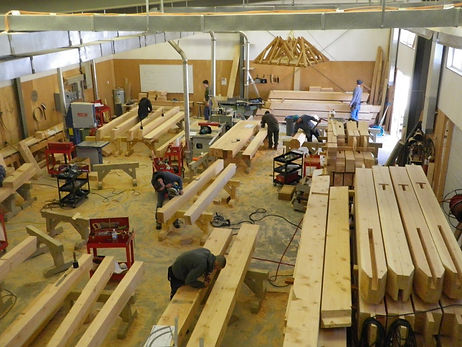 Wood workers fabricating mass timber