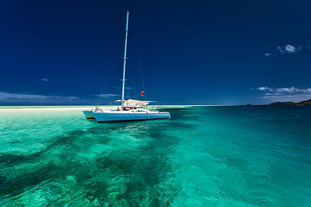 White catamaran in shallow tropical wate